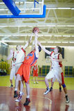 Scramble for ball under basket in game. MOSCOW - FEB 12: Scramble for ball under basket in game between CSKA and TRUDOVYE REZERVY in Russian State University of Royalty Free Stock Image
