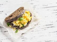 Scramble egg sandwich on  a light  wooden background. Healthy breakfast or snack Royalty Free Stock Photography