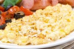 Scramble eggs with tomatoes, sausage and toast, close-up Stock Photography