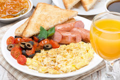 Scramble eggs with tomatoes, sausages, toast Royalty Free Stock Photography