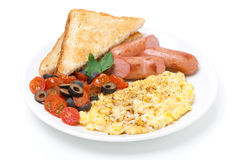 Scramble eggs with tomatoes, sausages and toast Stock Photo