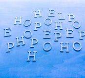 Scramblebokstäver på blå bakgrund Royaltyfri Bild