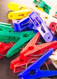 Scrambled colorful clothespin Stock Images