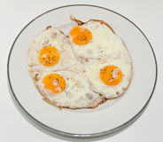 Scrambled Egg . Fried eggs of four eggs on a white plate stock image