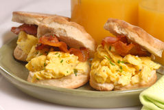 Scrambled egg and bacon biscuit. With orange juice Stock Photo