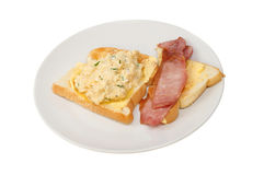 Scrambled egg and bacon Stock Images