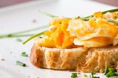 Scrambled egg on baguette Royalty Free Stock Images