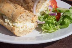 Scrambled Egg Baguette with Salad Stock Image