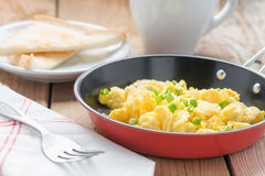 Scrambled egg with bread. Stock Photo