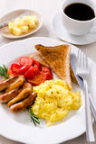 Scrambled egg breakfast with sausages, tomatoes and coffee Stock Images