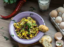 Scrambled egg with dried tomatoes and home baked goods Royalty Free Stock Photography