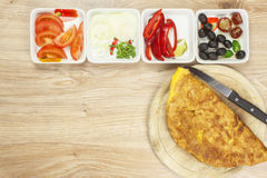 Scrambled egg omelet with vegetables on a wooden table. Stock Photos