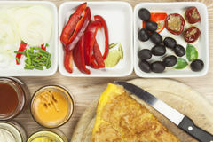 Scrambled egg omelet with vegetables on a wooden table. Stock Image