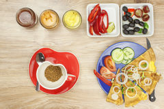Scrambled egg omelet with vegetables on a wooden table. Stock Photography