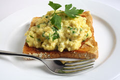 Scrambled egg with parsley on toast Stock Photography
