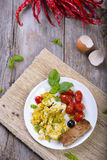 Scrambled egg. On a rustic wood background Royalty Free Stock Photo