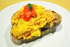 Scrambled egg on toast. Scrambled egg on a toast for breakfast Royalty Free Stock Photo