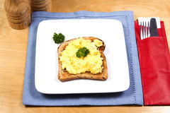 Scrambled egg on toast Stock Photos