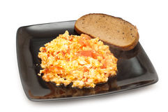 Scrambled egg and tomato Stock Photography
