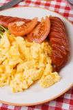Scrambled egg with tomato and grilled sausage Royalty Free Stock Photography