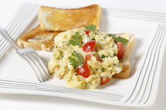 Scrambled egg and tomatoes on toast Stock Images