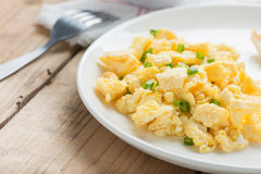 Scrambled egg on white plate. Royalty Free Stock Image