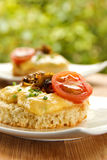 Scrambled Eggs. Creamy scrambled eggs with mushrooms and cherry tomato on toast for breakfast, shallow depth of field Royalty Free Stock Photography