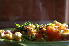 Scrambled eggs 2. Hot scrambled eggs, with tomatoes Royalty Free Stock Photo