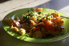 Scrambled eggs 2. Hot scrambled eggs, with tomatoes Stock Photo