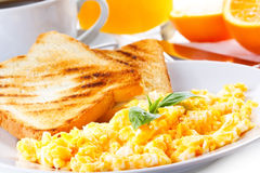 Scrambled eggs. Breakfast with scrambled eggs, toasts, juice and coffee Stock Photography