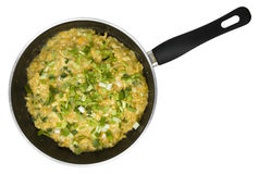 Scrambled eggs. With green onion in non-stick frying pan isolated on white Stock Image