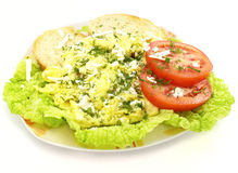 Scrambled eggs. A plate of scrambled eggs with toast bread tomato and lettuce Royalty Free Stock Images