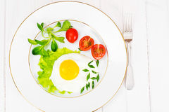 Scrambled Eggs with Arugula and Tomato. Health Food stock image