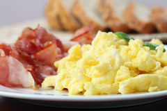Scrambled eggs and bacon stock images