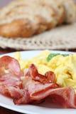 Scrambled eggs and bacon Stock Photos