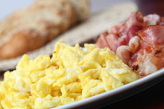 Scrambled eggs and bacon Stock Image
