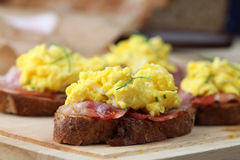 Scrambled eggs and bacon Stock Photos