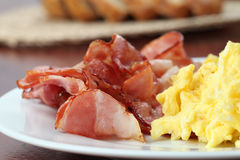 Scrambled eggs and bacon Royalty Free Stock Images
