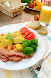 Scrambled eggs with bacon Royalty Free Stock Photos