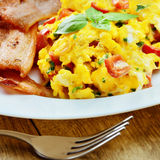 Scrambled eggs with bacon Royalty Free Stock Images