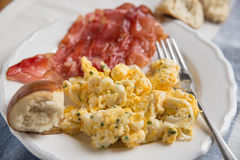 Scrambled eggs with bacon Stock Image