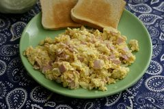 Scrambled eggs with bacon Stock Images