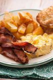 Scrambled eggs and bacon breakfast Royalty Free Stock Images