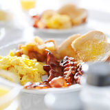 Scrambled eggs and bacon breakfast meal Stock Images