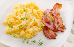 Scrambled eggs and bacon Royalty Free Stock Photography