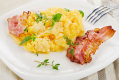 Scrambled eggs and bacon Stock Photo