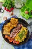 Scrambled eggs with bacon and French toast Royalty Free Stock Images