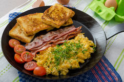 Scrambled eggs with bacon and French toast Royalty Free Stock Photos