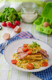 Scrambled eggs with bacon and French toast Stock Photo