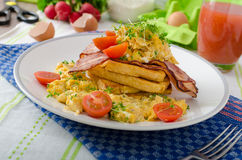 Scrambled eggs with bacon and French toast Stock Image